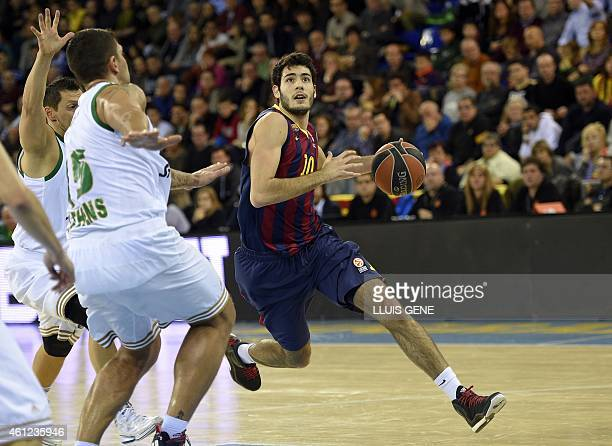 Barcelona's forward Alex Abrines vies with Panathinaikos Athens' player Esteban Batista during the Euroleague basketball match FC Barcelona vs...