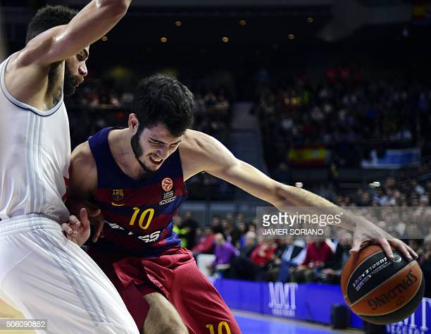 TOPSHOT Barcelona's forward Alex Abrines vies with Real Madrid's Swedish forward Jeffery Taylor during the Euroleague group F Top 16 round 4...