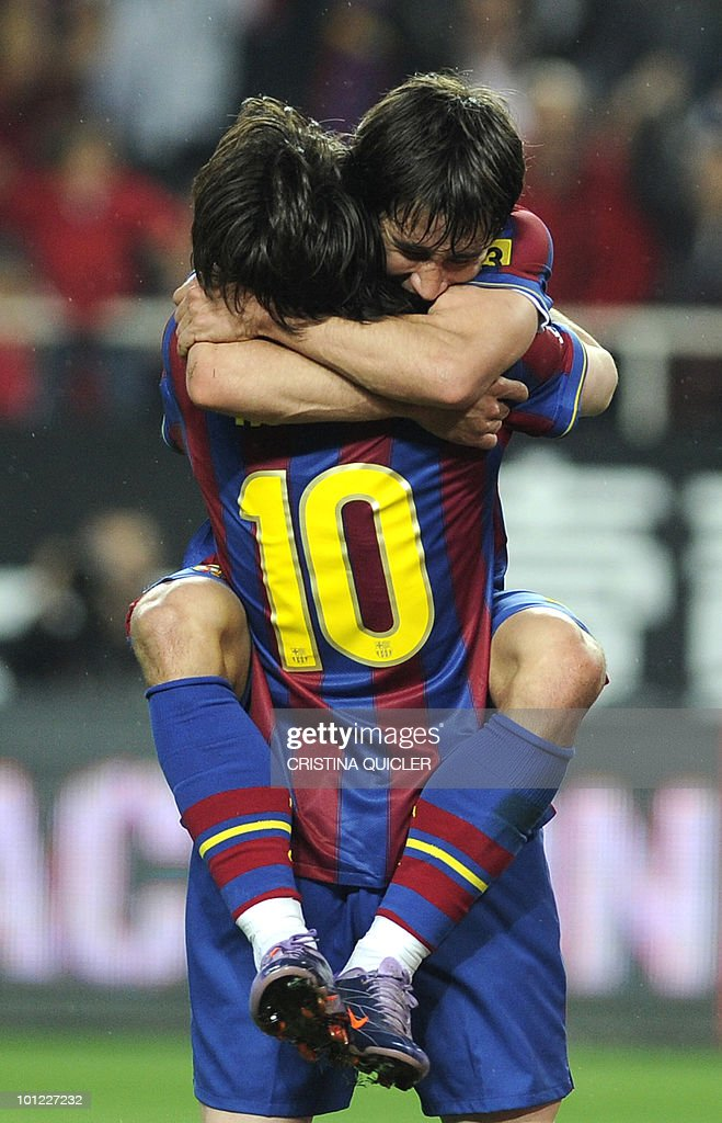 Barcelona's forward Bojan Krkic (up) celebrates with Barcelona's Argentinian forward Lionel Messi (down) after scoring a goal against Sevilla during a Spanish league football match at Sanchez Pizjuan stadium in Seville, on May 8, 2010.