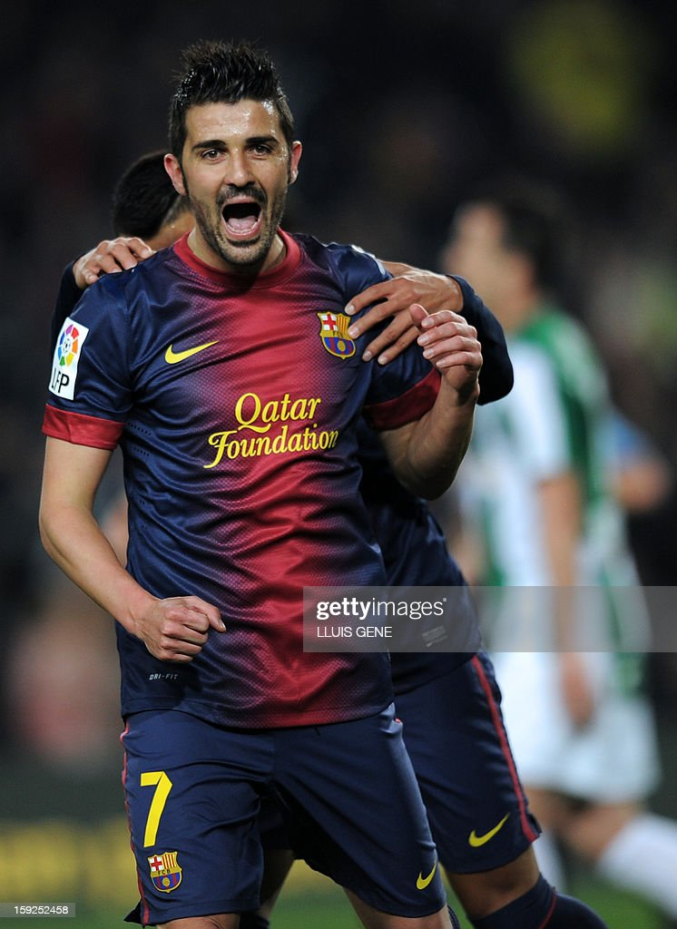 Barcelona's forward David Villa celebrates after scoring during the Spanish Copa del Rey (King's Cup) football match FC Barcelona vs Cordoba CF at the Camp Nou stadium in Barcelona on January 10, 2013.