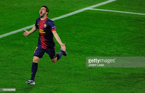 Barcelona's forward David Villa celebrates after scoring during the UEFA Champions League round of 16 second leg football match FC Barcelona against...