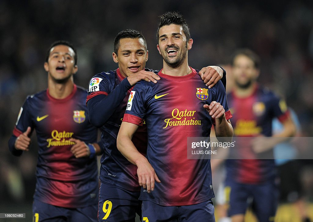 Barcelona's forward David Villa (R) celebrates with Barcelona's Chilean forward Alexis Sanchez after scoring during the Spanish Copa del Rey (King's Cup) football match FC Barcelona vs Cordoba CF at the Camp Nou stadium in Barcelona on January 10, 2013.