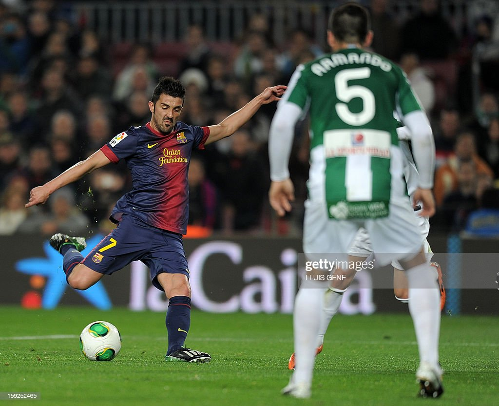 Barcelona's forward David Villa (L) scores during the Spanish Copa del Rey (King's Cup) football match FC Barcelona vs Cordoba CF at the Camp Nou stadium in Barcelona on January 10, 2013.