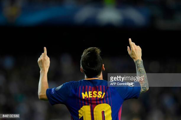 Barcelona's forward from Argentina Lionel Messi celebrates after scoring during the UEFA Champions League Group D football match FC Barcelona vs...