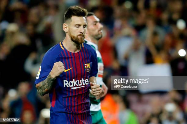 TOPSHOT Barcelona's forward from Argentina Lionel Messi celebrates after scoring during the Spanish league football match FC Barcelona against SD...