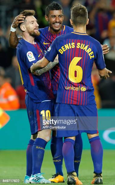 Barcelona's forward from Argentina Lionel Messi celebrates with teammates after scoring during the Spanish league football match FC Barcelona against...