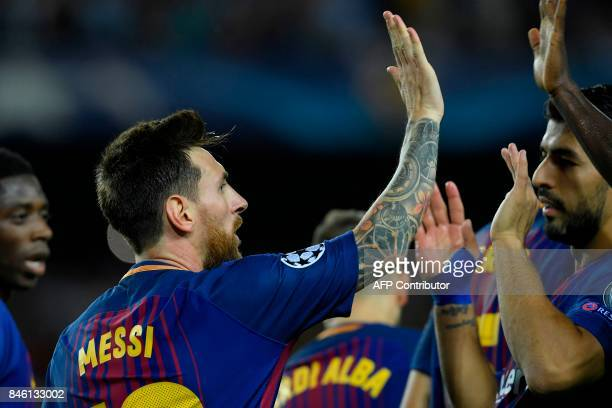 Barcelona's forward from Argentina Lionel Messi celebrates with Barcelona's forward from Uruguay Luis Suarez after scoring during the UEFA Champions...