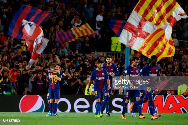 Barcelona's forward from Argentina Lionel Messi celebrates with Barcelona's defender from Spain Jordi Alba after scoring during the UEFA Champions...