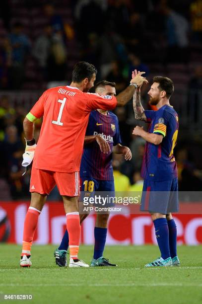 Barcelona's forward from Argentina Lionel Messi is congratulated by Juventus' goalkeeper from Italy Gianluigi Buffon at the end of the UEFA Champions...