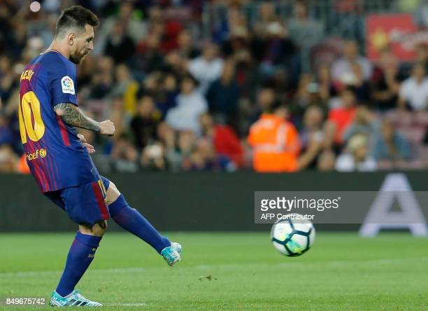 Barcelona's forward from Argentina Lionel Messi kicks a penalty during the Spanish league football match FC Barcelona against SD Eibar at the Camp...
