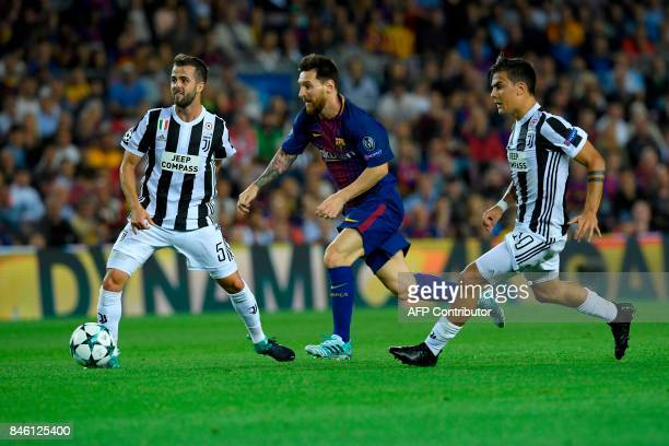 Barcelona's forward from Argentina Lionel Messi vies with Juventus' midfielder from BosniaHerzegovina Miralem Pjanic and Juventus' forward from...