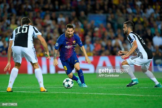 Barcelona's forward from Argentina Lionel Messi vies with Juventus' defender from Italy Andrea Barzagli and Juventus' midfielder from...