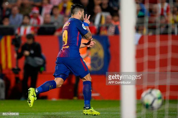 Barcelona's forward from Uruguay Luis Suarez celebrates after scoring during the Spanish league football match Girona FC vs FC Barcelona at the...