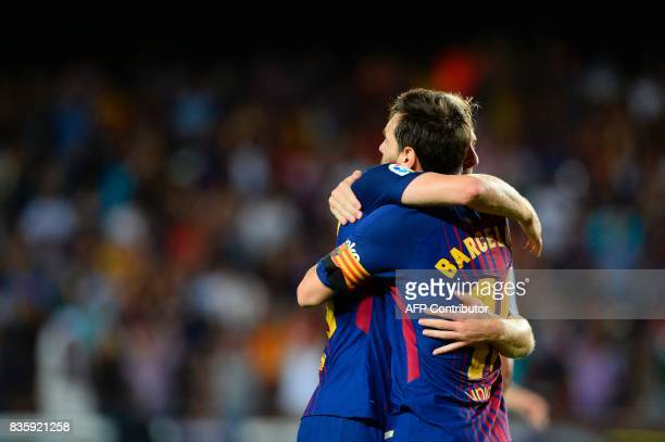 Barcelona's forward Gerard Deulofeu and Barcelona's Argentinian forward Lionel Messi after an own goal of Betis during the Spanish league footbal...