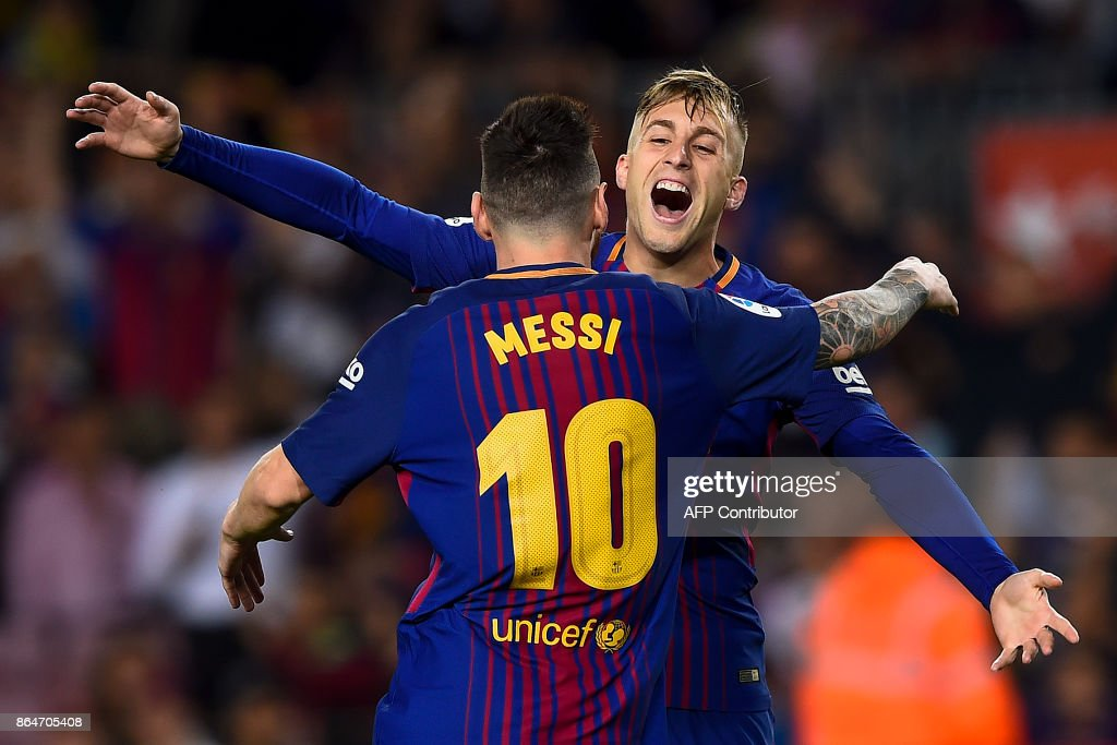 Barcelona's forward Gerard Deulofeu (R) celebrates with Barcelona's Argentinian forward Lionel Messi after scoring a goal during the Spanish league football match FC Barcelona vs Malaga CF at the Camp Nou stadium in Barcelona on October 21, 2017. / AFP PHOTO / Josep LAGO