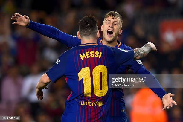 Barcelona's forward Gerard Deulofeu celebrates with Barcelona's Argentinian forward Lionel Messi after scoring a goal during the Spanish league...
