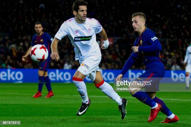 Barcelona's forward Gerard Deulofeu in action against Murcia's defender David Mateos during the Spanish Copa del Rey football match between FC...