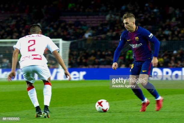 Barcelona's forward Gerard Deulofeu in action against Murcia's argentinian defender Federico Vera during the Spanish Copa del Rey football match...