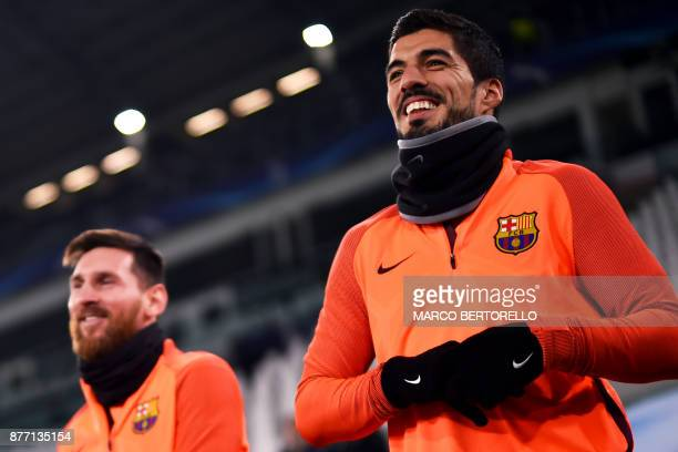 Barcelona's forward Lionel Messi from Argentina and Barcelona's forward Luis Suarez from Uruguay attend a training session on the eve of the UEFA...