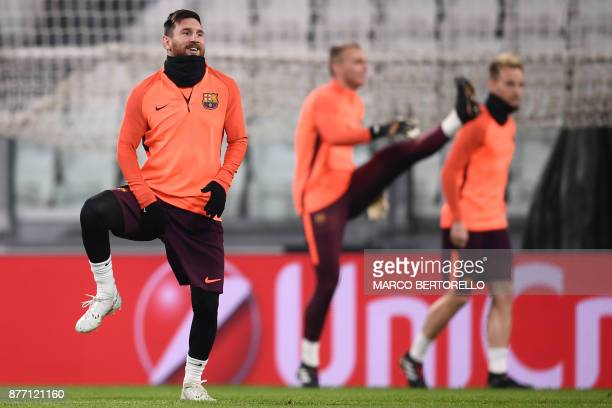 Barcelona's forward Lionel Messi from Argentina attends a training session on the eve of the UEFA Champions League football match Juventus Vs...