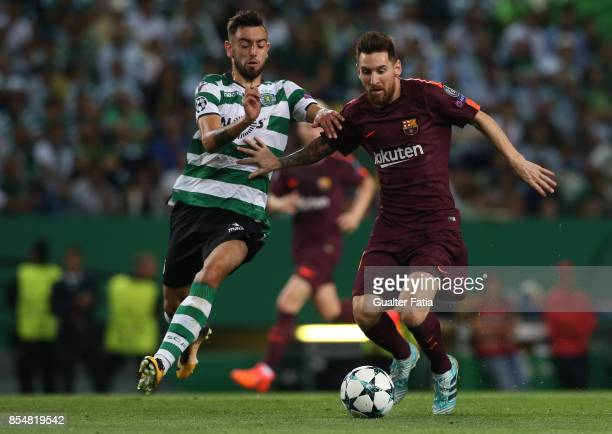 Barcelona's forward Lionel Messi from Argentina with Sporting CP midfielder Bruno Fernandes from Portugal in action during the UEFA Champions League...