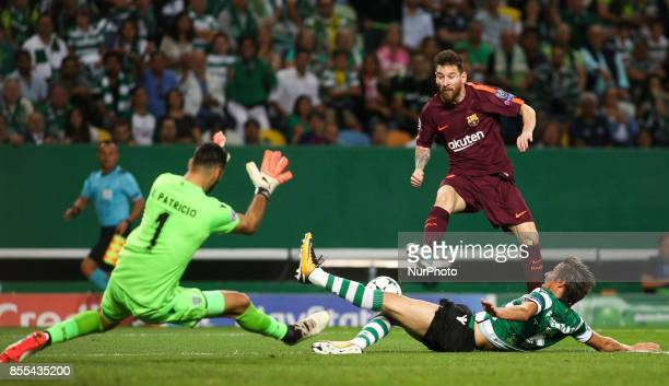 Barcelona's forward Lionel Messi vies with Sporting's defender Fabio Coentrao and Sporting's goalkeeper Rui Patricio during the Champions League...