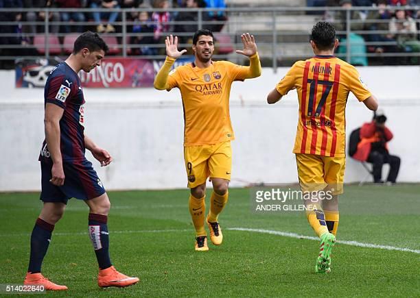Barcelona's forward Munir El Haddadi celebrates with Barcelona's Uruguayan forward Luis Suarez after scoring during the Spanish league football match...