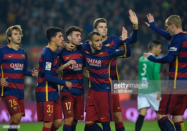 Barcelona's forward Munir El Haddadi celebrates with Barcelona's midfielder Sergi Samper Barcelona's forward Aitor Cantalapiedra Barcelona's forward...