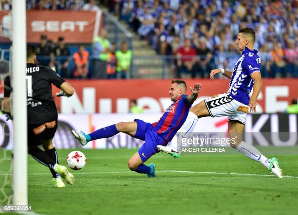 Barcelona's forward Munir El Haddadi vies with Deportivo Alaves' Moroccan defender Zouhair Feddal during the Spanish Copa del Rey final football...