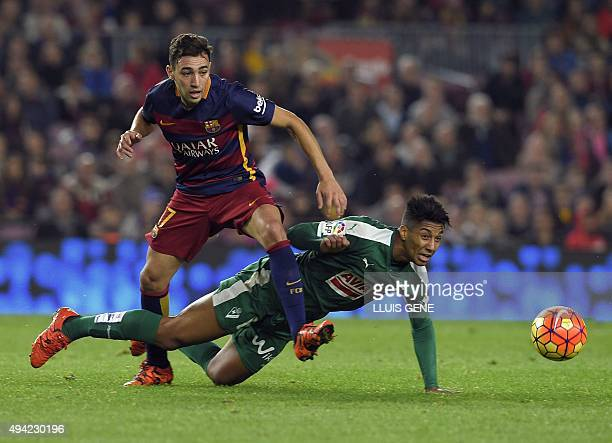 Barcelona's forward Munir El Haddadi vies with Eibar's Azerbaijani midfielder Eddy during the Spanish league football match FC Barcelona vs SD Eibar...