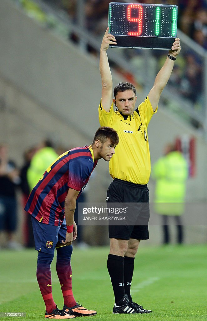 Barcelona's forward Neymar da Silva Santos (L) waits to enter the pitch during their preseason friendly football match Lechia Gdansk vs FC Barcelona at the PGE Arena in Gdansk, on July 30, 2013. The match ended 2-2. SKARZYNSKI