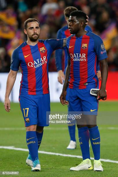 Barcelonas forward Paco Alcacer and Barcelona's French defender Samuel Umtiti react to their disqualification by Juventus at the end of the UEFA...