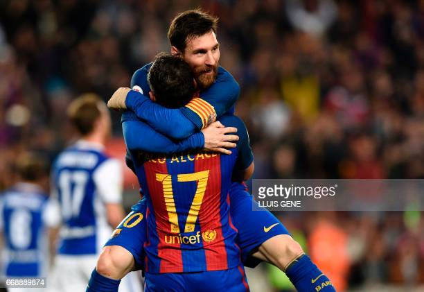Barcelona's forward Paco Alcacer celebrates a goal with Barcelona's Argentinian forward Lionel Messi during the Spanish league football match FC...