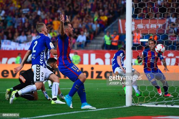 Barcelona's forward Paco Alcacer celebrates after Barcelona's Brazilian forward Neymar scored during the Spanish Copa del Rey final football match FC...