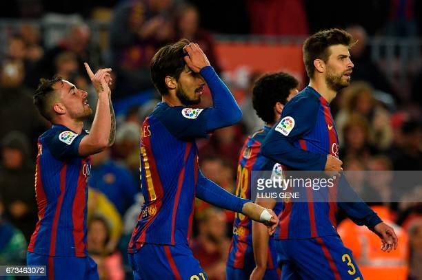 Barcelona's forward Paco Alcacer celebrates after scoring a goal during the Spanish league football match FC Barcelona vs CA Osasuna at the Camp Nou...