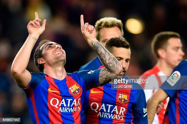 Barcelona's forward Paco Alcacer celebrates after scoring during the Spanish league football match FC Barcelona vs Real Sporting de Gijon at the Camp...
