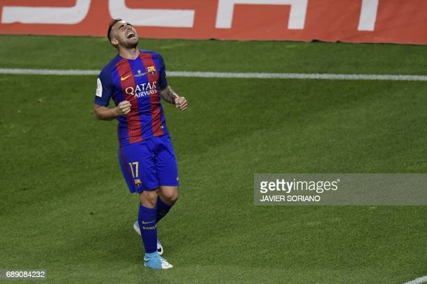 Barcelona's forward Paco Alcacer celebrates after scoring their third goal during the Spanish Copa del Rey final football match FC Barcelona vs...