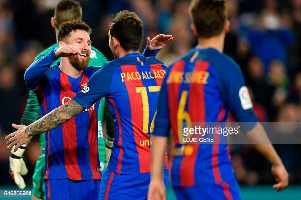 TOPSHOT Barcelona's forward Paco Alcacer celebrates with Barcelona's Argentinian forward Lionel Messi after scoring during the Spanish league...