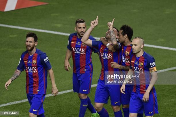 Barcelona's forward Paco Alcacer celebrates with teammates after scoring their third goal during the Spanish Copa del Rey final football match FC...