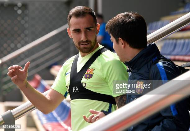 Barcelona's forward Paco Alcacer chats with a teammate as he arrives for a training session at the Sports Center FC Barcelona Joan Gamper in Sant...