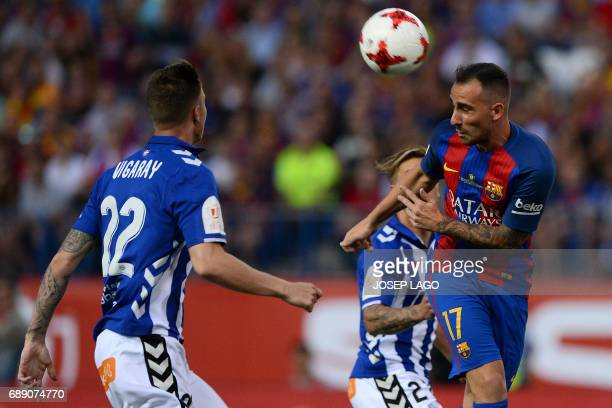 Barcelona's forward Paco Alcacer heads the ball during the Spanish Copa del Rey final football match FC Barcelona vs Deportivo Alaves at the Vicente...