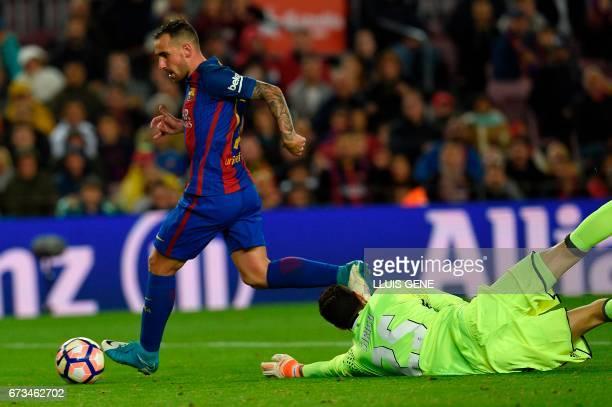 Barcelona's forward Paco Alcacer scores a goal past Osasuna's Italian goalkeeper Sirigu during the Spanish league football match FC Barcelona vs CA...