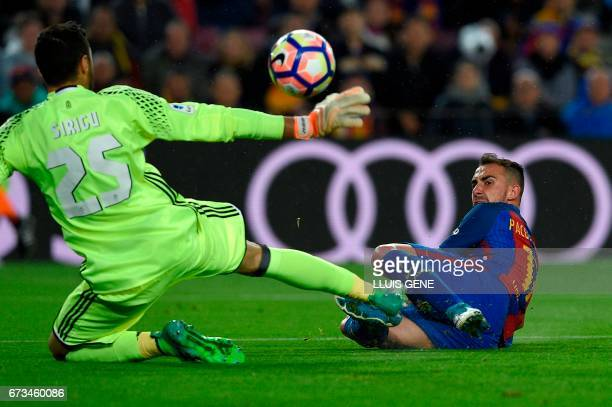 TOPSHOT Barcelona's forward Paco Alcacer scores a goalpast Osasuna's Italian goalkeeper Sirigu during the Spanish league football match FC Barcelona...