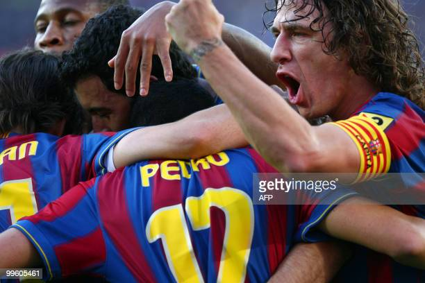 Barcelona's forward Pedro Rodriguez and Barcelona's captain Carles Puyol celebrate after scoring against Valladolid during a Spanish League football...