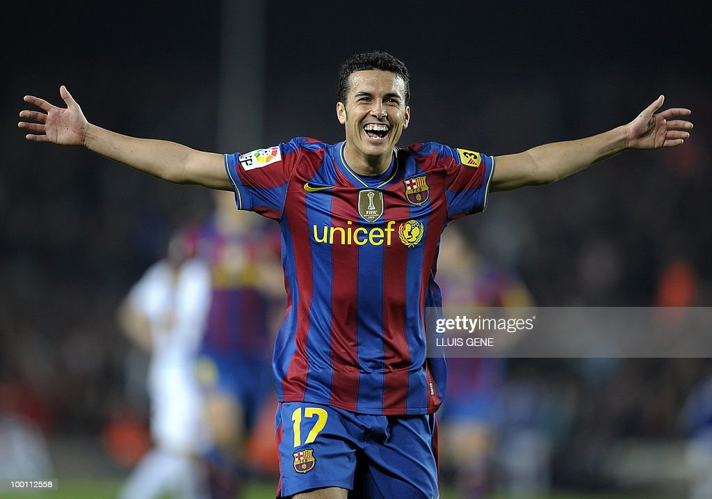 Barcelona's forward Pedro Rodriguez celebrates after scoring against Deportivo Coruna during their Spanish League football match between on April 14, 2010 at Camp Nou stadium in Barcelona.