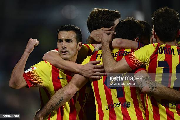 Barcelona's forward Pedro Rodriguez celebrates after scoring their fifth goal during the Spanish league football match Getafe vs Barcelona at...