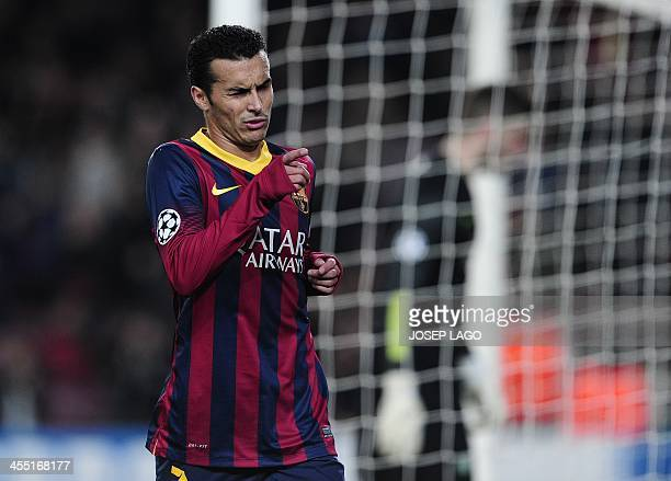 Barcelona's forward Pedro Rodriguez celebrates his goal during the UEFA Champions League Group H football match FC Barcelona vs Celtic FC at the Camp...