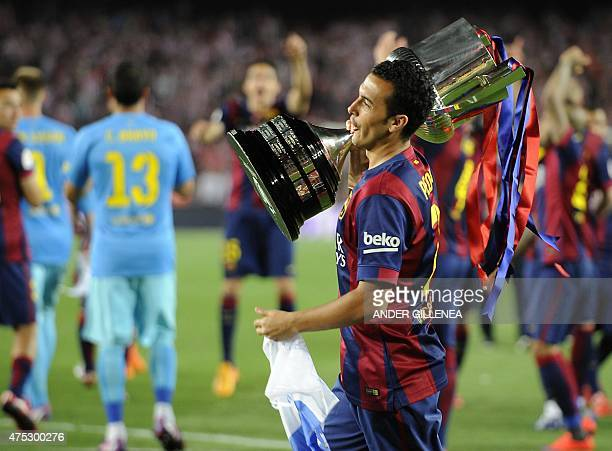 Barcelona's forward Pedro Rodriguez celebrates with the trophy after winning the Spanish Copa del Rey final football match Athletic Club Bilbao vs FC...