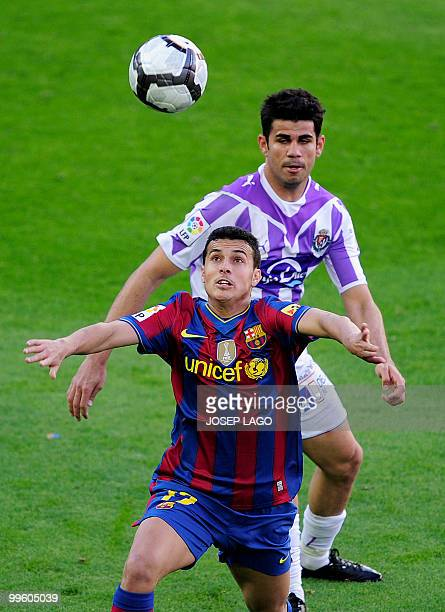 Barcelona's forward Pedro Rodriguez fights for the ball with Valladolid's Brazilian forward Diego Costa during a Spanish League football match...