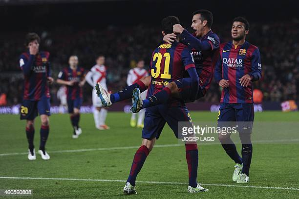 Barcelona's forward Pedro Rodriguez is congratulated by his teammate Barcelona's forward Munir el Haddadi after scoring during the Spanish Copa del...